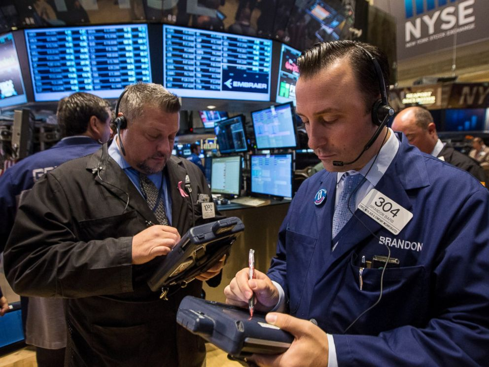 PHOTO: Traders work on the floor of the New York Stock Exchange October 1, 2014.