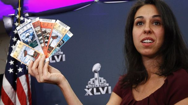 PHOTO: NFL Vice President for Legal Affairs Anastasia Danias holds up samples of counterfeit tickets