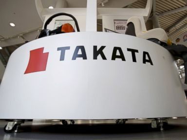 PHOTO: A logo of Takata Corp is seen with its display at a showroom for vehicles in Tokyo, May 8, 2015.