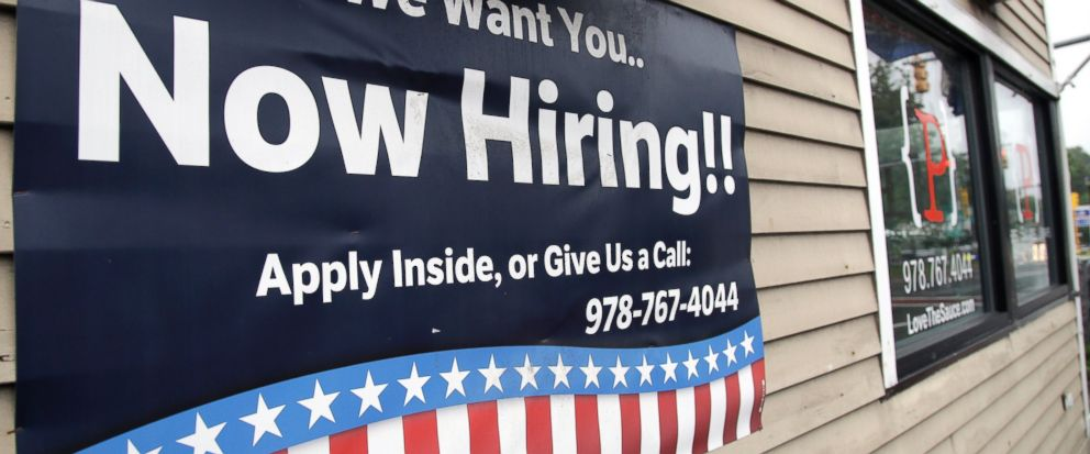 In this July 24, 2017, photo, a sign advertising employment hangs outside a restaurant in Middleton, Mass. On Tuesday, Aug. 8, 2017, the Labor Department reports on job openings and labor turnover for June. (AP Photo/Elise Amendola)