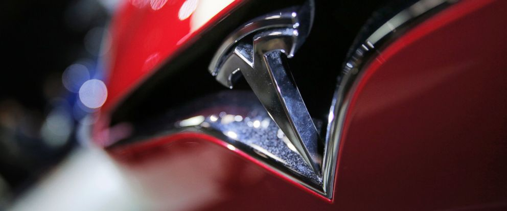 FILE - This Friday, Sept. 30, 2016, file photo shows the logo of the Tesla Model S on display at the Paris Auto Show in Paris. A Minnesota man is blaming Tesla's partially self-driving Autopilot system for a crash on Saturday, July 15, 2017, in Hawic