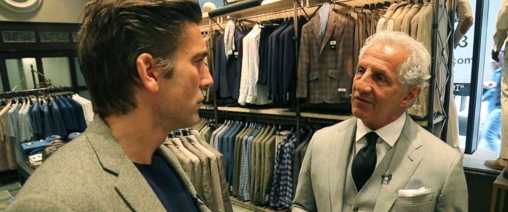 PHOTO: US menswear designer Joseph Abboud talks Italian suits made in America with ABC News David Muir in Boston.