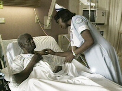 VIDEO: Nurse tends to a patient.