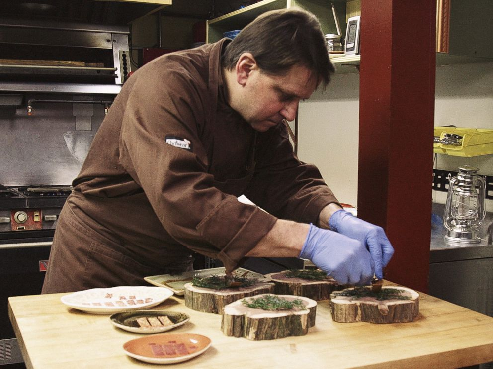 PHOTO: Damon Baehrel prepares dishes in his basement restaurant in Earlton, New York, Oct. 27, 2015.