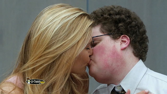 PHOTO: Supermodel Bar Refaeli locks lips with actor Jesse Heiman in an ad for GoDaddy.