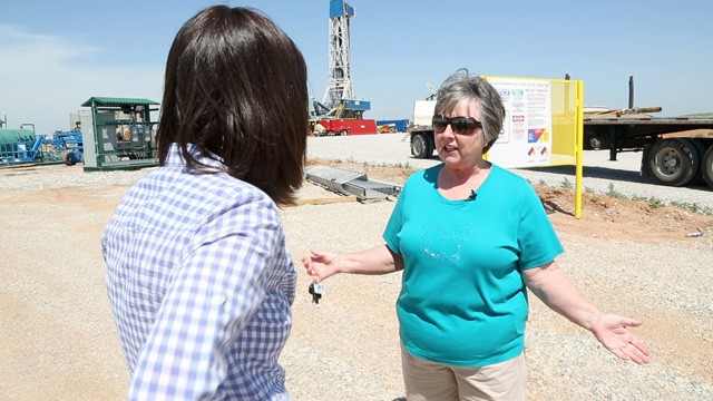 PHOTO: Susan Croft of Anthony, Kan., stands in front of the oil well being drilled on part of her 3,000 acres of farmland.
