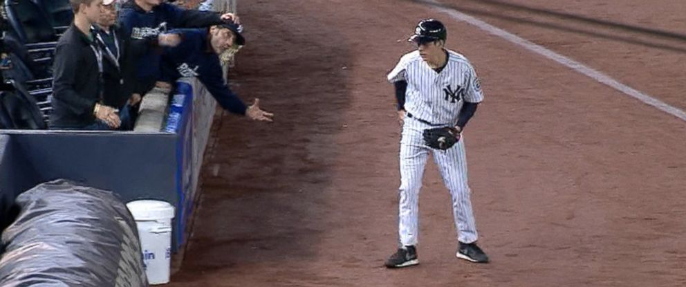 PHOTO: A ball boy for the Yankees appeared to pocket a foul ball hit by Derek Jeter during his final game, Sept. 26, 2014.
