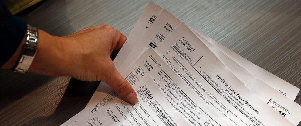 PHOTO: A woman holds tax forms in Boulder, Colo. on Jan. 14, 2017.