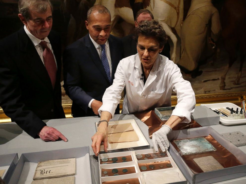 PHOTO: Museum of Fine Arts Boston Head of Objects Conservation Pam Hatchfield displays objects removed a time capsule