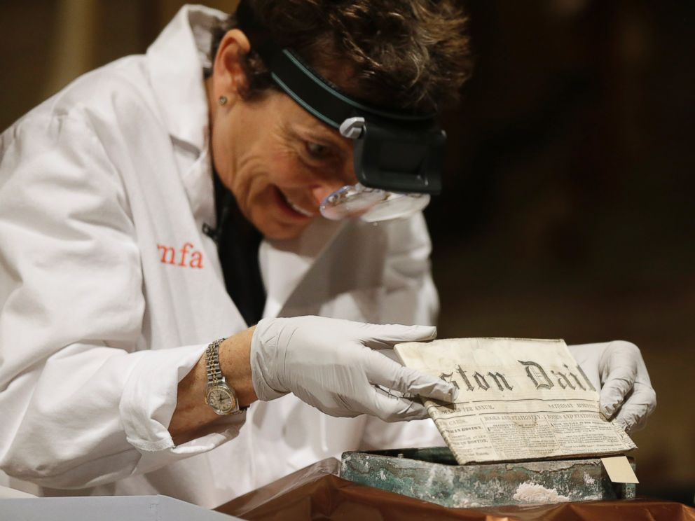 PHOTO: Museum of Fine Arts Boston Head of Objects Conservation Pam Hatchfield removes a folded 19th century newspaper from a time capsule at the museum, Jan. 6, 2015, in Boston.