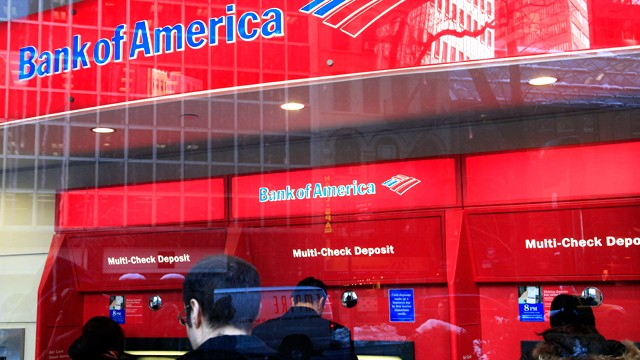 PHOTO: Bank of America customers use ATM machines in New York City.