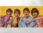 "PHOTO: This photo provided by Heritage Auctions of Dallas shows a a copy of The Beatles ""Sgt. Peppers Lonely Hearts Club Band"" album autographed by all four band members."