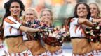 PHOTO: Cincinnati Bengals cheerleaders perform during an NFL preseason football game against the Tennessee Titans, August 17, 2013, at Paul Brown Stadium in Cincinnati, Ohio.