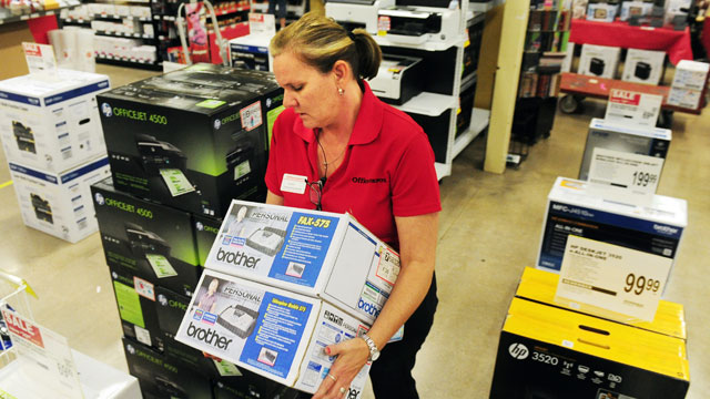 PHOTO: Office Depot Customer Service Specialist Cindy Carmichael arranges merchandise for the Black Friday sale on Nov. 21, 2012 in Abilene, Texas.