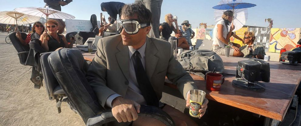"""PHOTO: A """"Mobile Board Room"""" moves along the playa at the Burning Man festival in Gerlach, Nev., Aug. 29, 2013."""