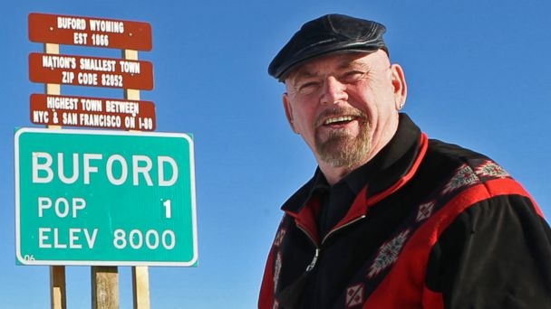 PHOTO: Buford resident Don Sammons stands in front of the population sign for the town of Buford, Wyo.