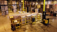 PHOTO: In this Nov. 16, 2012 photo, employees work at a shipping area of Generac Power Systems, Inc., one of the largest makers of residential generators in the U.S., in Whitewater, Wis.