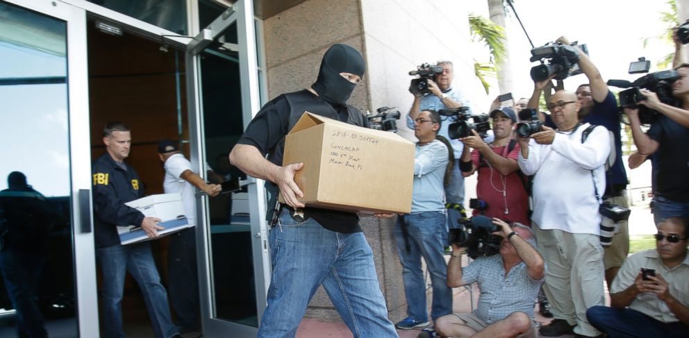 PHOTO: Federal agents carry boxes of evidence taken from the headquarters of the Confederation of North, Central America and Caribbean Association Football, May 27, 2015, in Miami Beach, Fla.