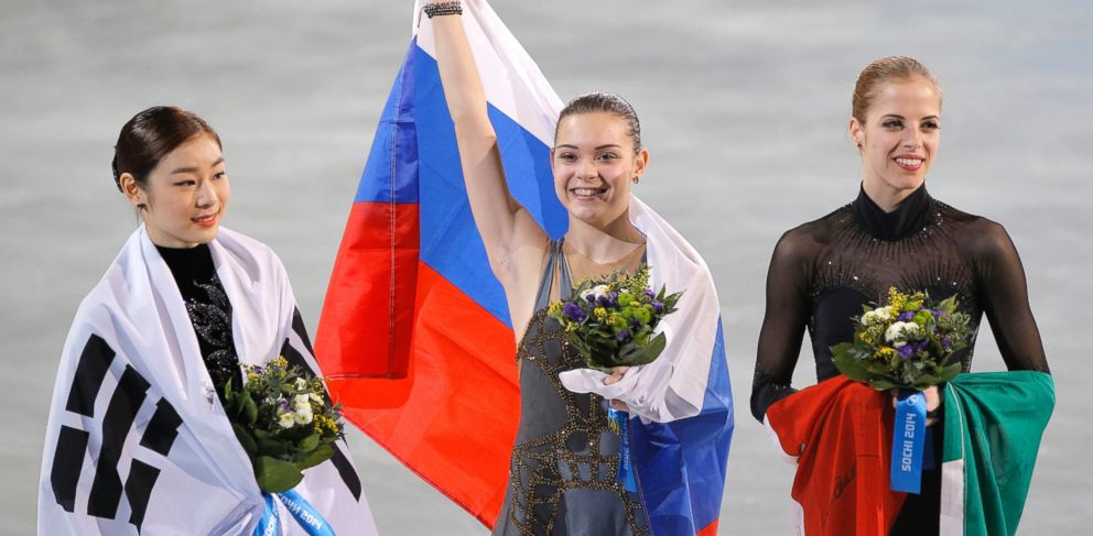 PHOTO: Adelina Sotnikova of Russia, center, Yuna Kim of South Korea, left, and Carolina Kostner of Italy celebrate after the womens free skate figure skating final at the 2014 Winter Olympics, Iceberg Skating Palace, Feb. 20, 2014, in Sochi, Russia.