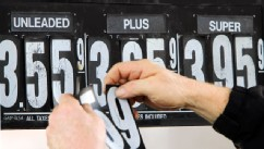 PHOTO: Gas station manager Fred Oliver, of Lisbon Falls, Maine, changes the price of gasoline on the pumps at a station in Topsham, Maine, Feb. 7, 2012. Gas prices are expected to rise as high as four dollars by Spring.