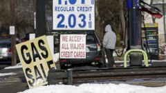 PHOTO: In this Jan. 9, 2015 file photo, gas prices close to two dollars a gallon are seen at a service station in Leonia, N.J.