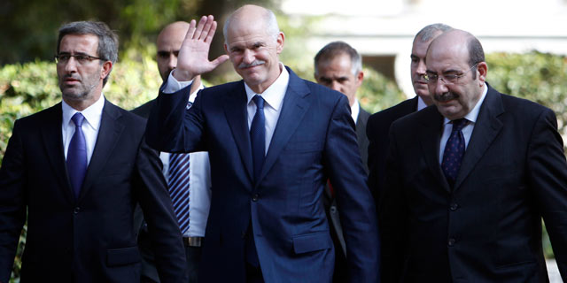 PHOTO: Outgoing Prime Minister George Papandreou leaves the presidential palace in Athens on Nov. 10, 2011.