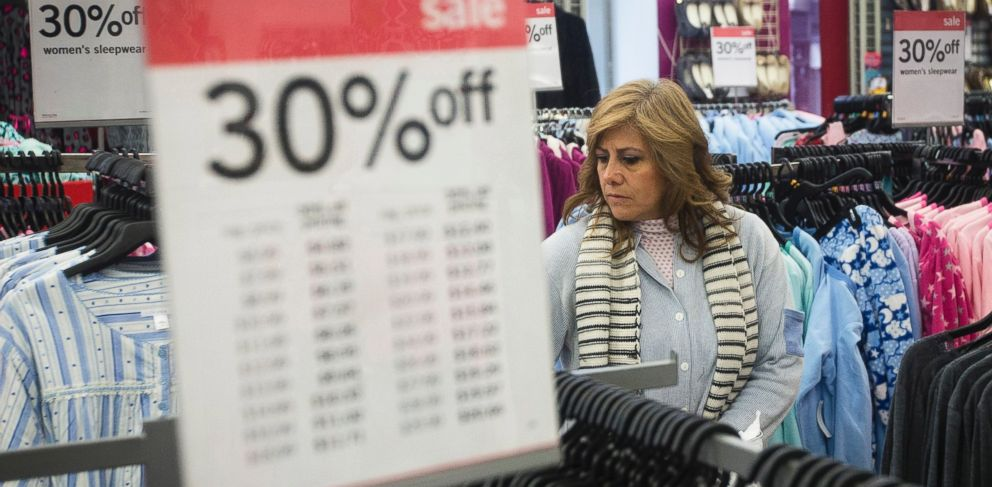 PHOTO: In this Thursday, Nov. 27, 2014 file photo, Giselle Basurto, of Mexico, shops at a Kmart store in New York on Thanksgiving Day.
