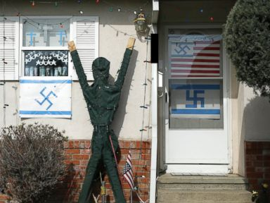 PHOTO: Swastikas, a Palestinian flag, and a wooden statue with arms raised adorn a home in a Sacramento, Calif. on Feb. 26, 2015.