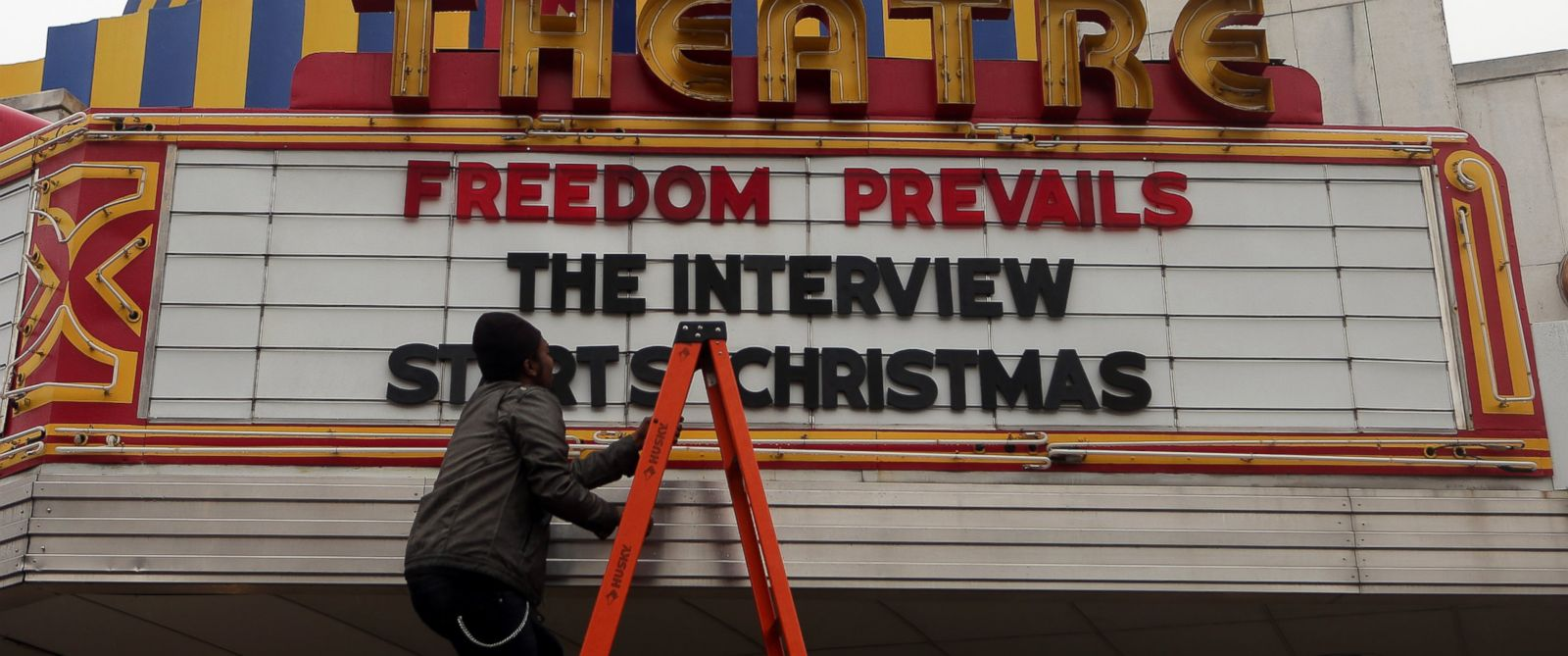 "PHOTO: Brandon Delaney, general manager of the Plaza Theatre, in Atlanta, Ga., finishes hanging the marquis Tuesday, Dec. 23, 2014 to announce that the theatre will be showing ""The Interview."""