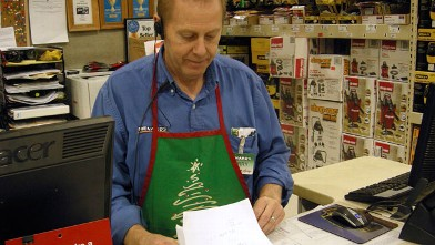 PHOTO: Larry Boutilier, hardware manager, who has been with the Minot, N.D. Menards since 1996, looks over paperwork at the store on Nov. 29, 2012; The home improvement retailer says it will hire workers from its home base in Wisconsin and fly them to Nor