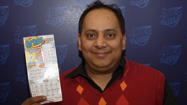PHOTO: This undated photo provided by the Illinois Lottery shows Urooj Khan, 46, of Chicago's West Rogers Park neighborhood, posing with a winning lottery ticket.