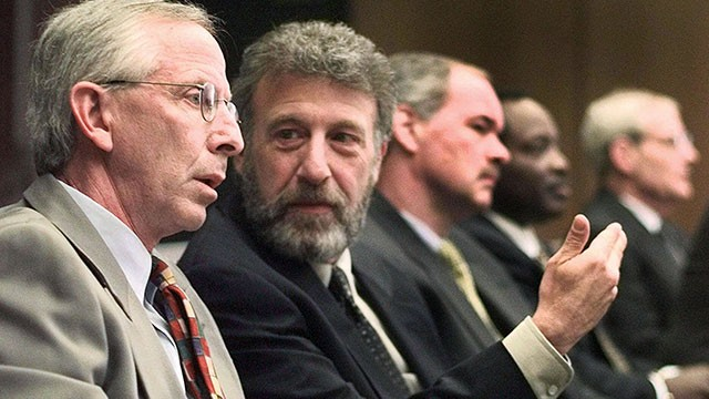 PHOTO: In this May 6, 1999 file photo, George Zimmer, second from left, gestures to Andy Dolich prior to a meeting, in Oakland, Calif.