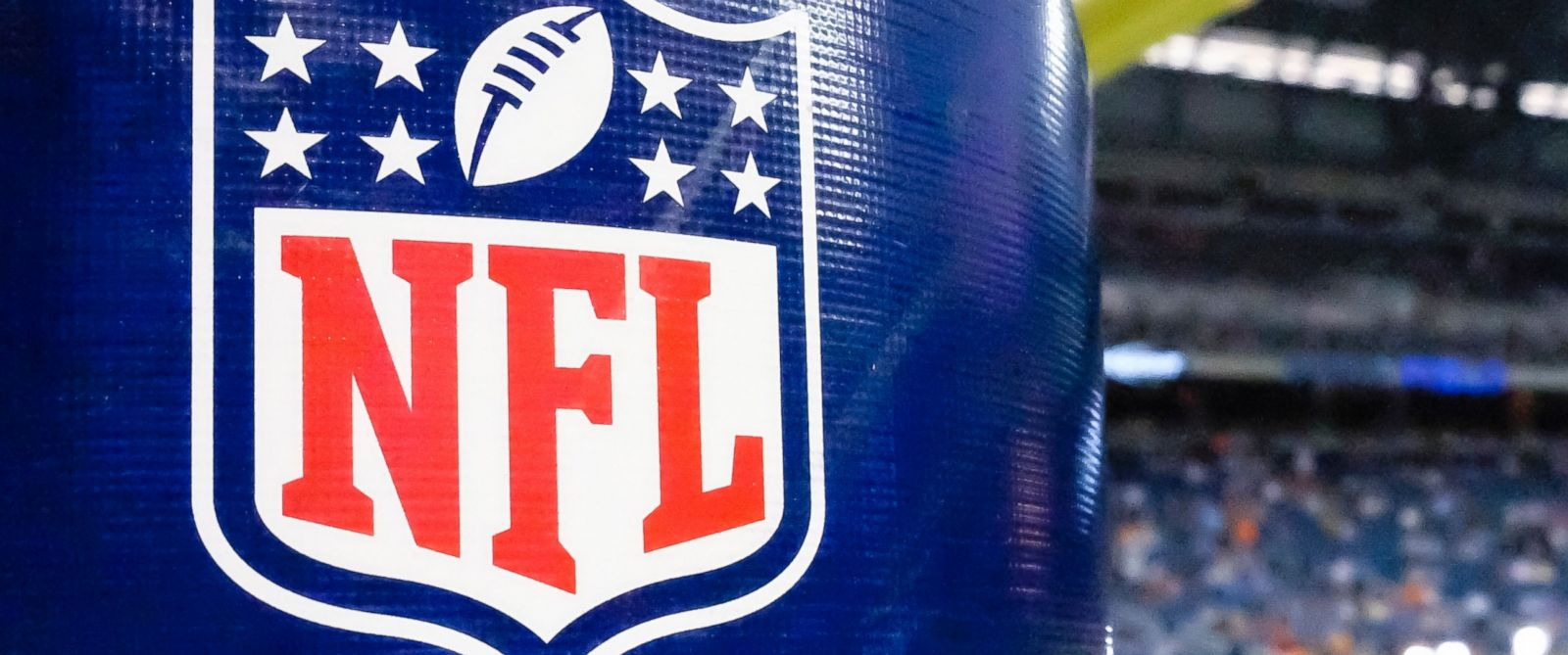 PHOTO: This Aug. 9, 2014 file photo shows an NFL logo on a goal post padding before a preseason NFL football game between the Detroit Lions and the Cleveland Browns at Ford Field in Detroit.