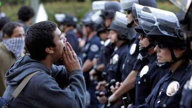 A protester chants his slogans in front of police officers during a rally in Los Angeles on Nov. 17, 2011.