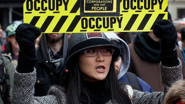 PHOTO: An Occupy Wall Street protester holds a sign during a march towards midtowns Bryant Park Feb. 29, 2012, in New York.