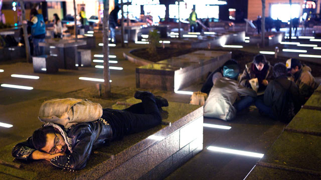 PHOTO: An Occupy Wall Street protestor rests in a newly tent-free Zuccotti Park during the early morning hours, Nov. 16, 2011, in New York.