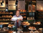 PHOTO: Panera Bread Co. CEO Ron Shaich stands behind a counter in a St. Louis cafe.