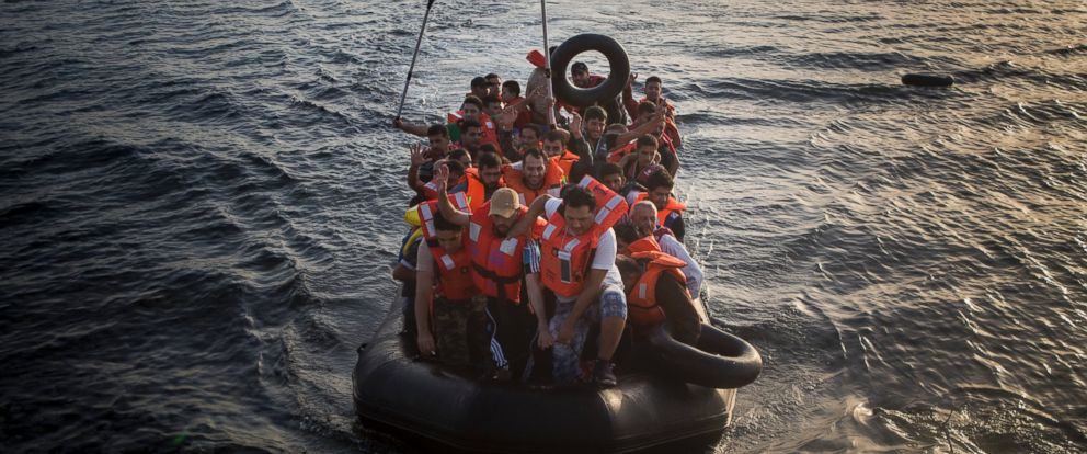 PHOTO: Refugees and migrants who crossed from Turkey aboard a dinghy approach the coast of the northeastern Greek island of Lesbos, Sept. 7, 2015.