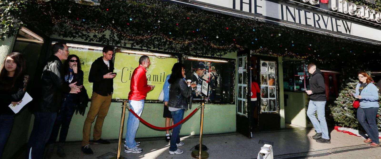 "PHOTO: Patrons queue up to see ""The Interview"" at the the Cinefamily at Silent Movie Theater in Los Angeles on Dec. 25, 2014."