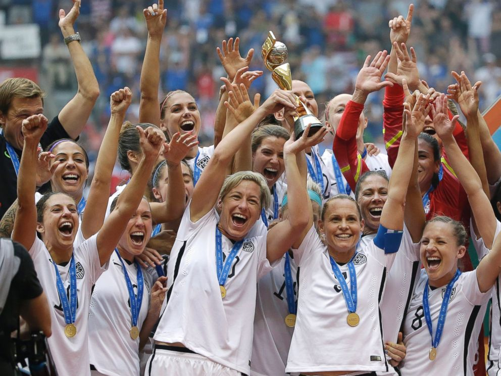The united states women s national team celebrates with the trophy