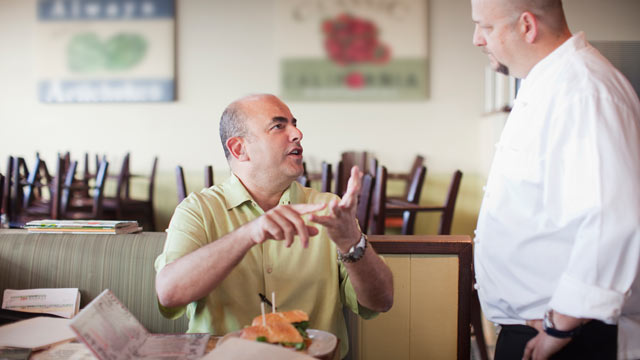 PHOTO: Angry customer complains to the chef in a restaurant.