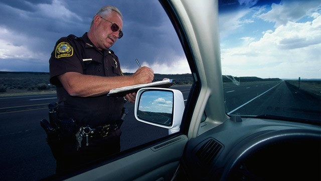 PHOTO: Sheriff writing a speeding ticket