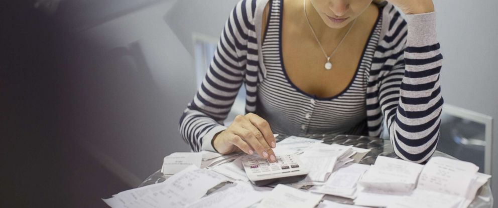 PHOTO: A woman is pictured planning her financial budget in this undated stock photo.