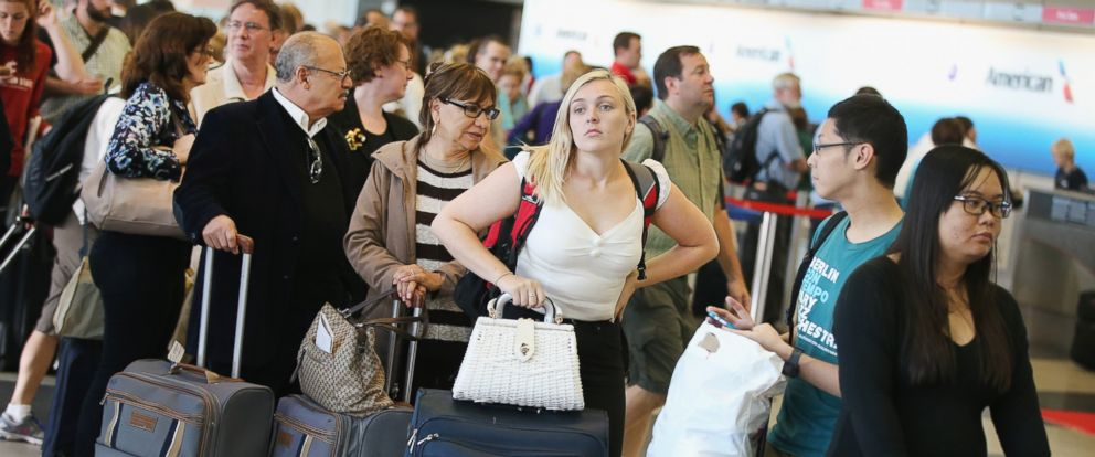 PHOTO: Passengers wait in line to reschedule flights at OHare International Airport Sept. 26, 2014, in Chicago.