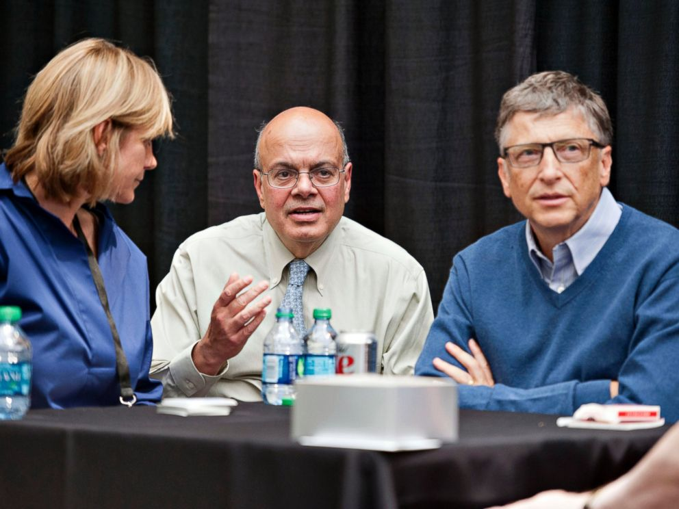 PHOTO: Ajit Jain, head of the Berkshire Hathaway reinsurance business, center, sits next to Bill Gates, chairman and founder of Microsoft Corp. at the Berkshire Hathaway shareholders meeting in Omaha, Nebraska, May 4, 2014.