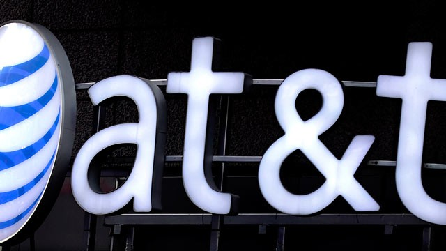 PHOTO: AT&T Inc. signage is displayed outside of a store in New York, U.S., Dec. 16, 2011.