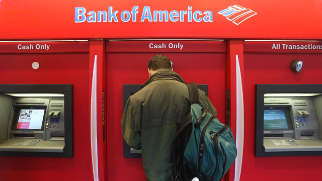 PHOTO: A man stands in a Bank of America ATM in New York City.