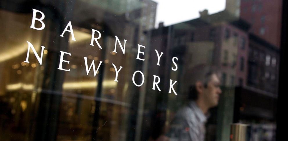 PHOTO: A shopper walks through the entrance of a Barneys New York store in New York, in this July 5, 2007 photo.