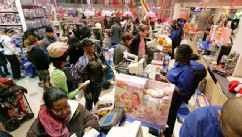 PHOTO:Shoppers stand in line to pay for their goods at Toys