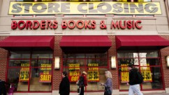 PHOTO: Pedestrians pass by a Borders book store with signs announcing that it will be closing its doors, March 4, 2001, in Washington.